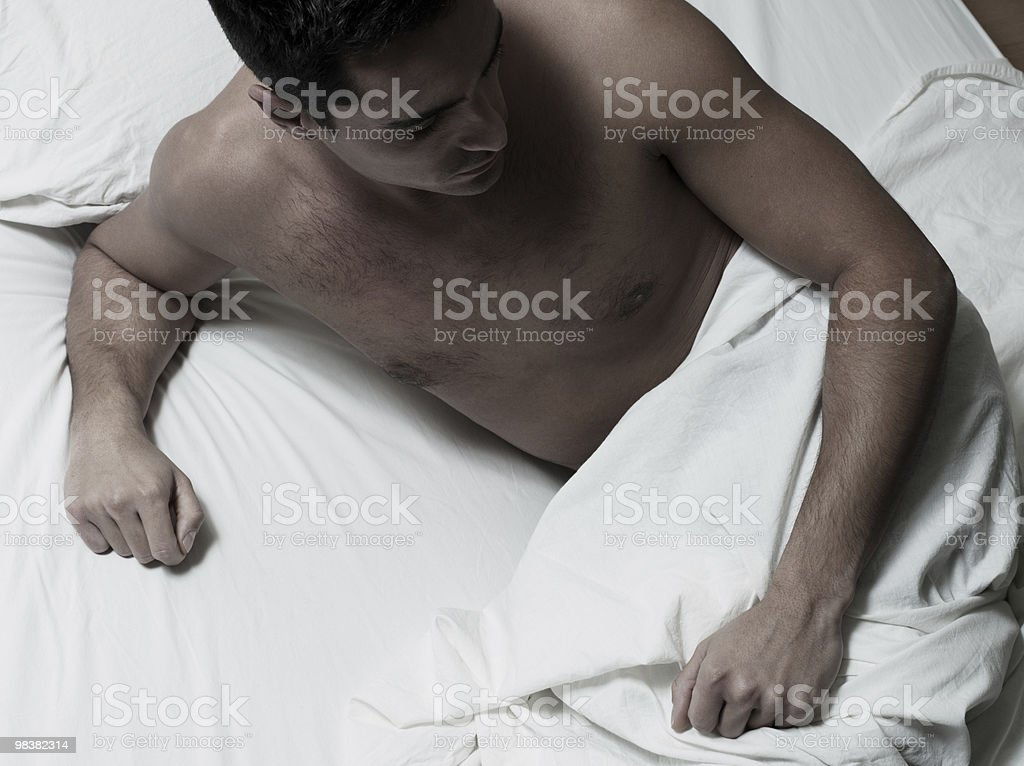 sleepless Man sitting in a bed pensive insomnia sadness royalty-free stock photo