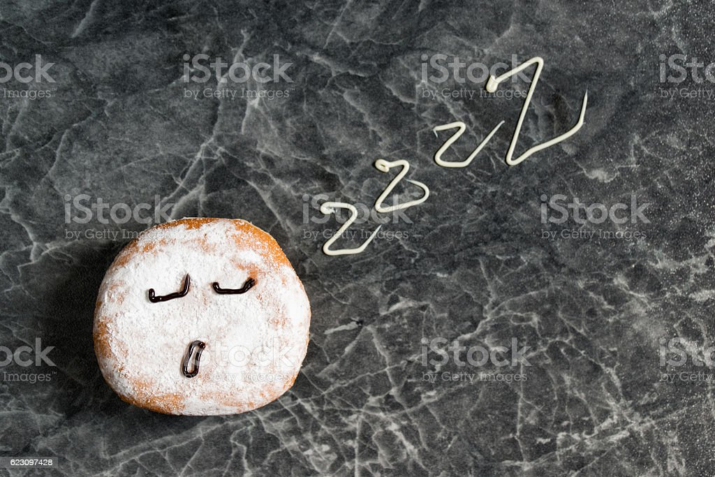 Sleepy donut, sleep sign, smiley face with zzz stock photo