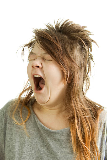 sleepy girl yawning - messy hair stock photos and pictures