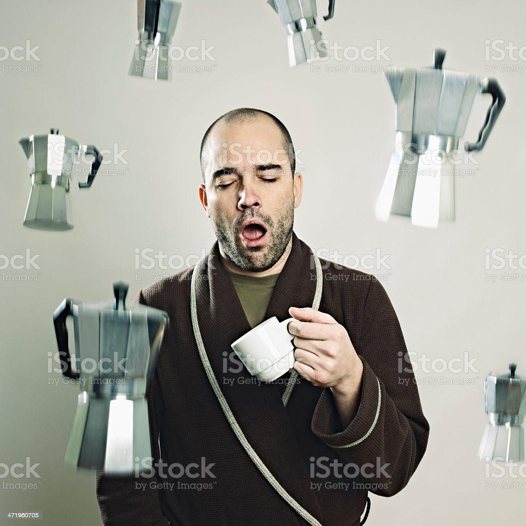 Sleepy Man with flying coffee machines stock photo