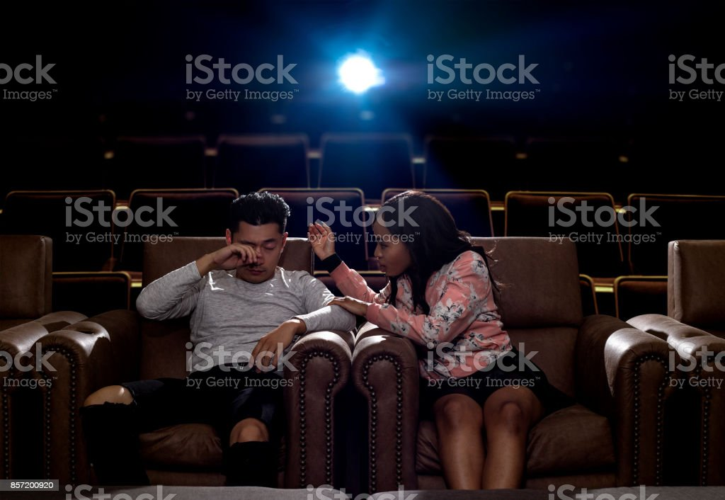 Sleepy or Bored Date in a Movie Theater stock photo