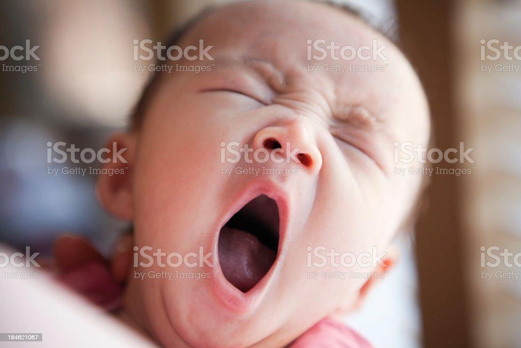 Sleepy Three Months Old Asian Baby Yawning stock photo