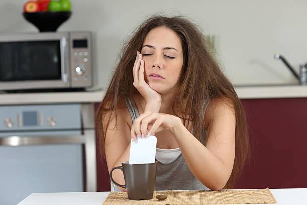 sleepy tired girl with a bad wake up - geschlossene küchen stock-fotos und bilder