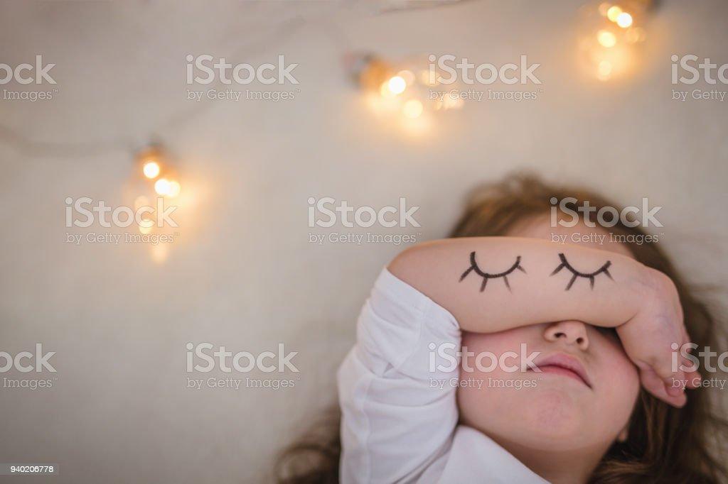 Sleepy toddler girl in bed stock photo