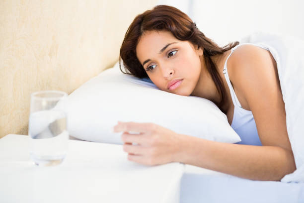 sleepy woman in her bed - sleeping pill stock photos and pictures