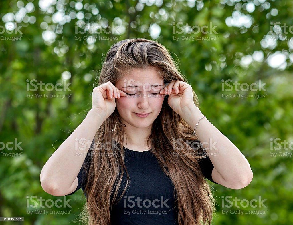 Sleepy Woman rubbing her Eyes stock photo