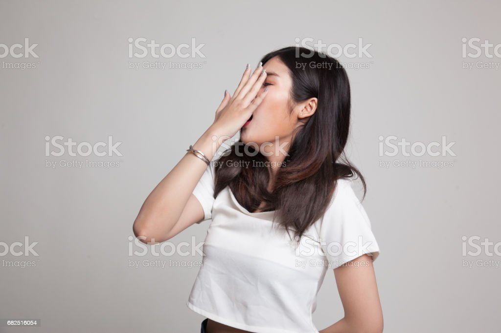 Sleepy young Asian woman yawn. royalty-free stock photo