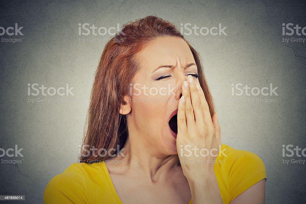 sleepy young woman yawning eyes closed bored stock photo