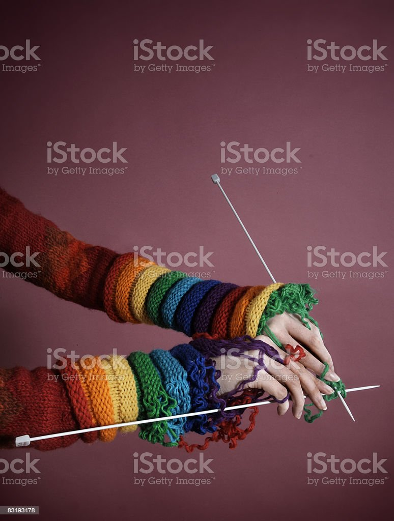 Sleeves being knitted and worn at the same time royalty-free stock photo