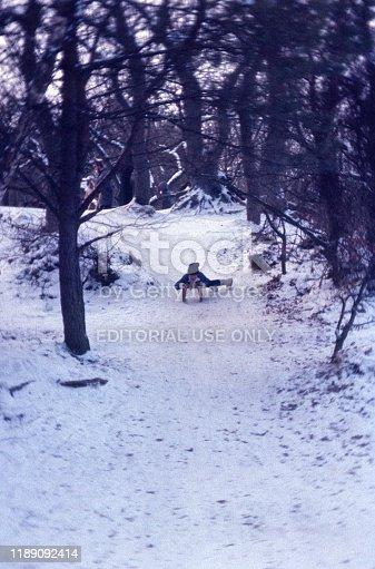 Berlin (West), Germany, 1976. Young tobogganing in winter Grunewald, Berlin