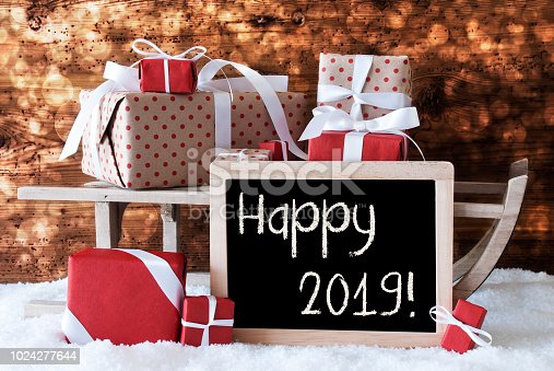 istock Sleigh With Gifts, Snow, Bokeh, Text Happy 2019 1024277644