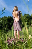 istock Slender beautiful girl takes off her dress. 1023343636