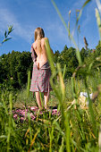 istock Slender beautiful girl takes off her dress. 1041679688