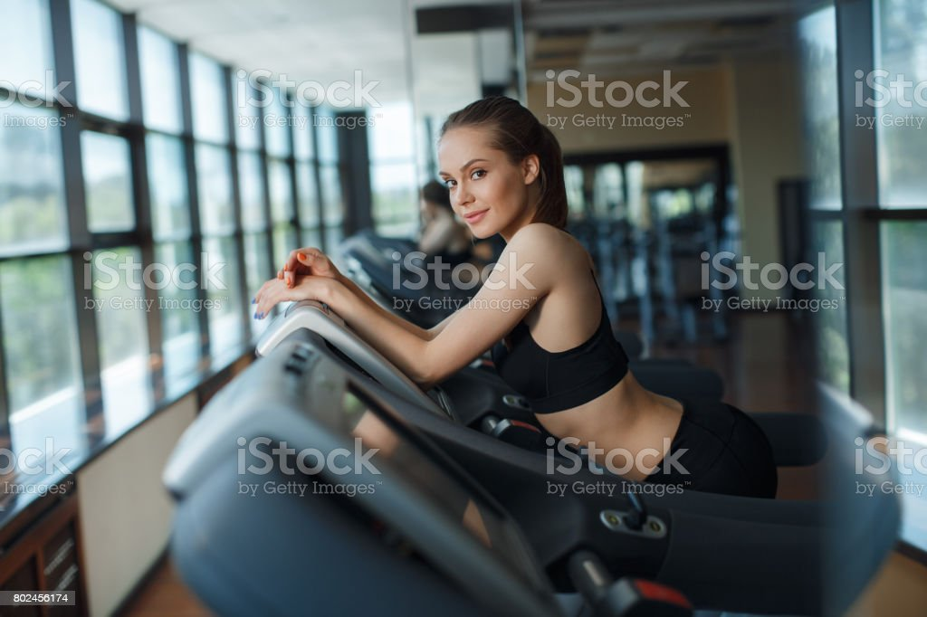 Slender Beautiful Woman In A Fitness Center Stock Photo