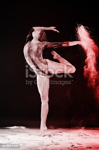 istock Slender blonde dancing in white dust studio shot 943821432
