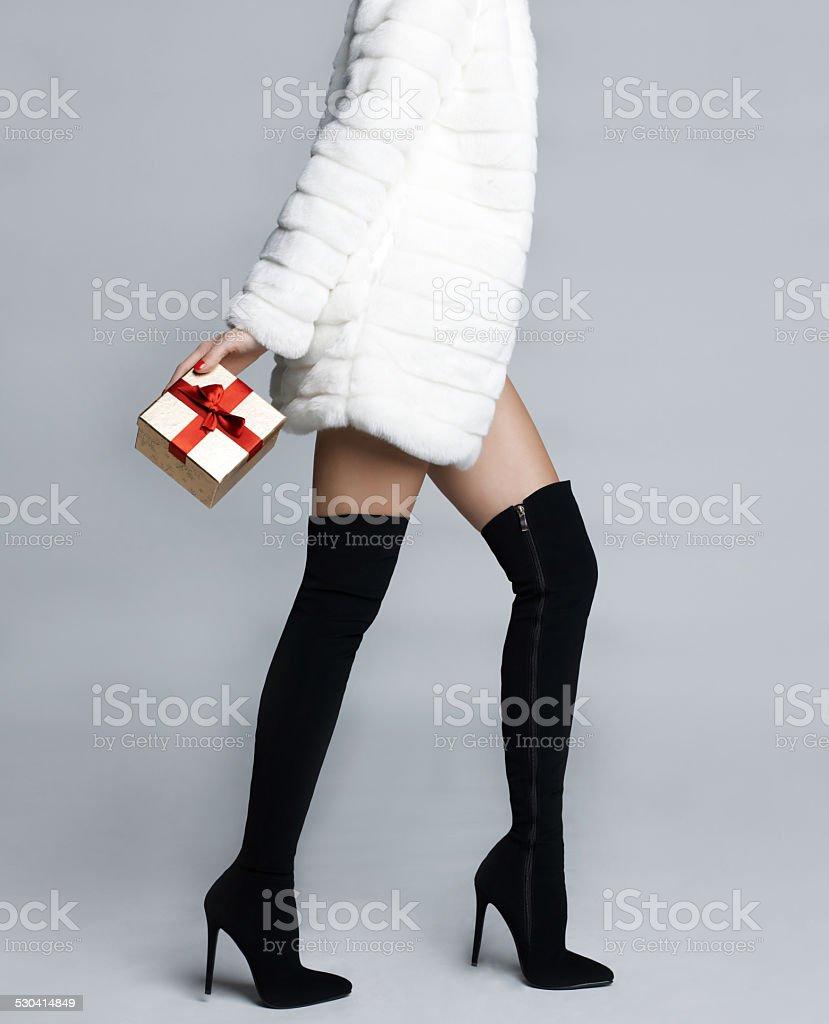 Slender female legs in boots stockings stock photo