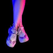 Slender female legs in white sneakers. Trend neon lights.