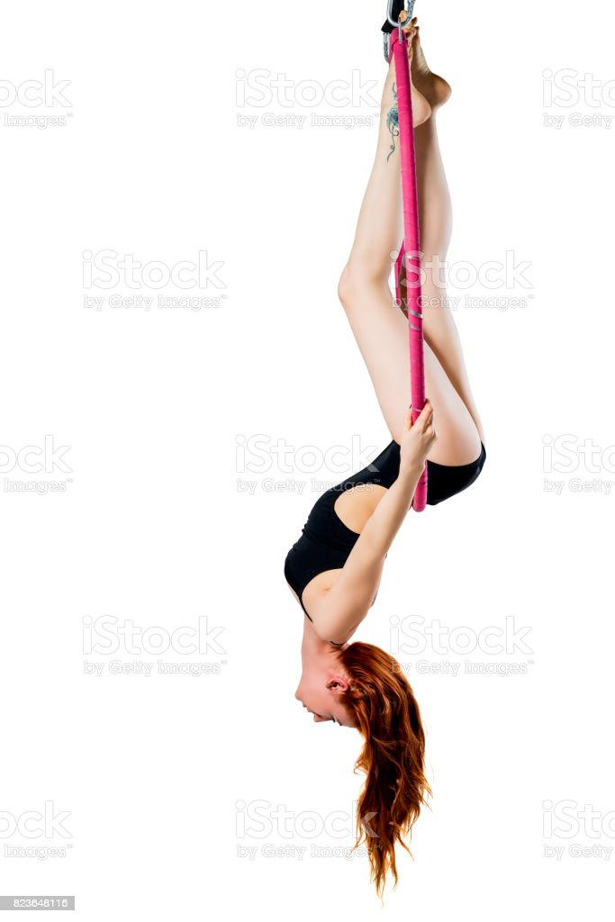 Slender girl in the air ring in training on a white background stock photo