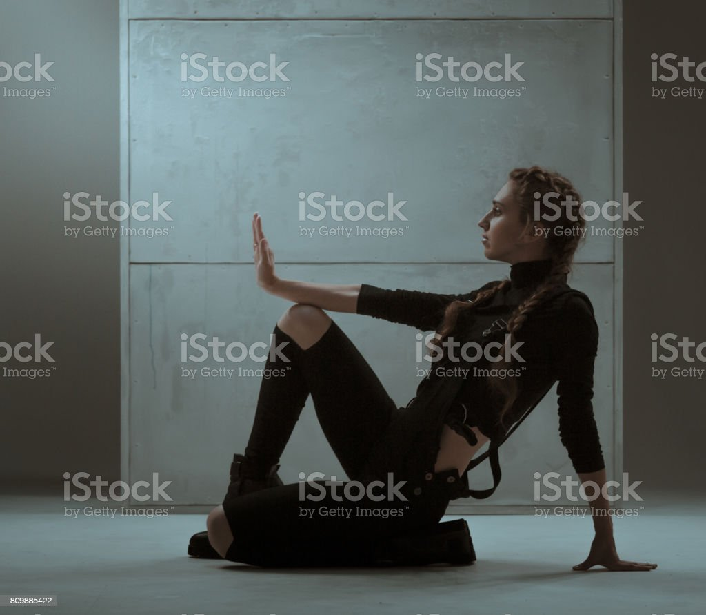 Slender Woman In Vogue Dance Pose stock photo