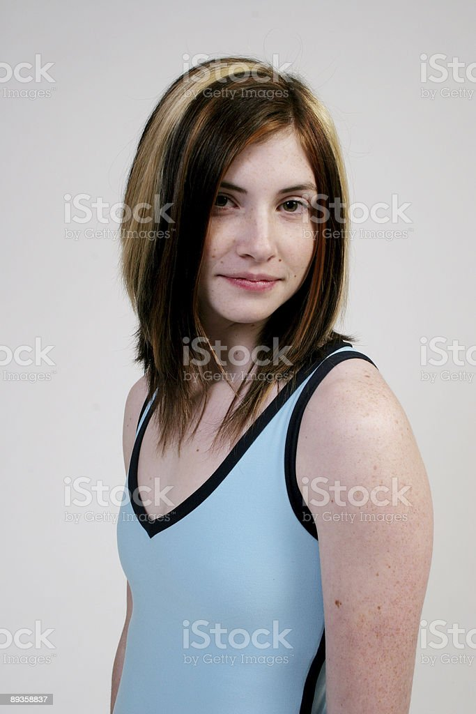 Slender young woman in tennis outfit royalty free stockfoto