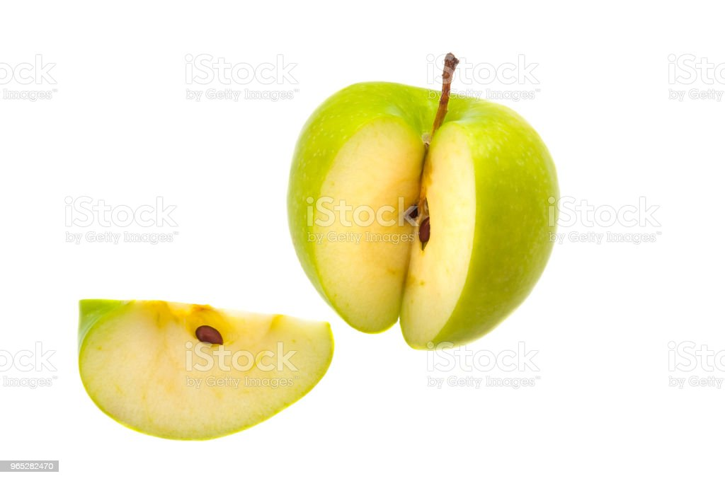 Slice is cut off from a large fresh green apple. Isolated. zbiór zdjęć royalty-free
