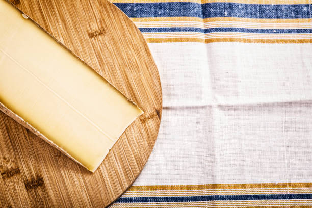 slice of a french cheese Comte stock photo