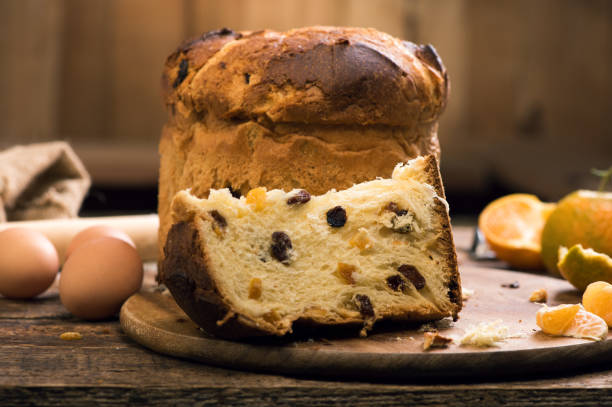 slice of a panettone. italian christmas cake - panettone foto e immagini stock