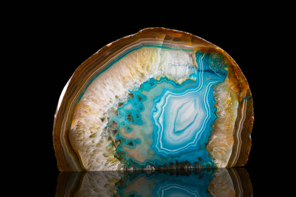 Slice Of Agate Crystal isolated on black background stock photo