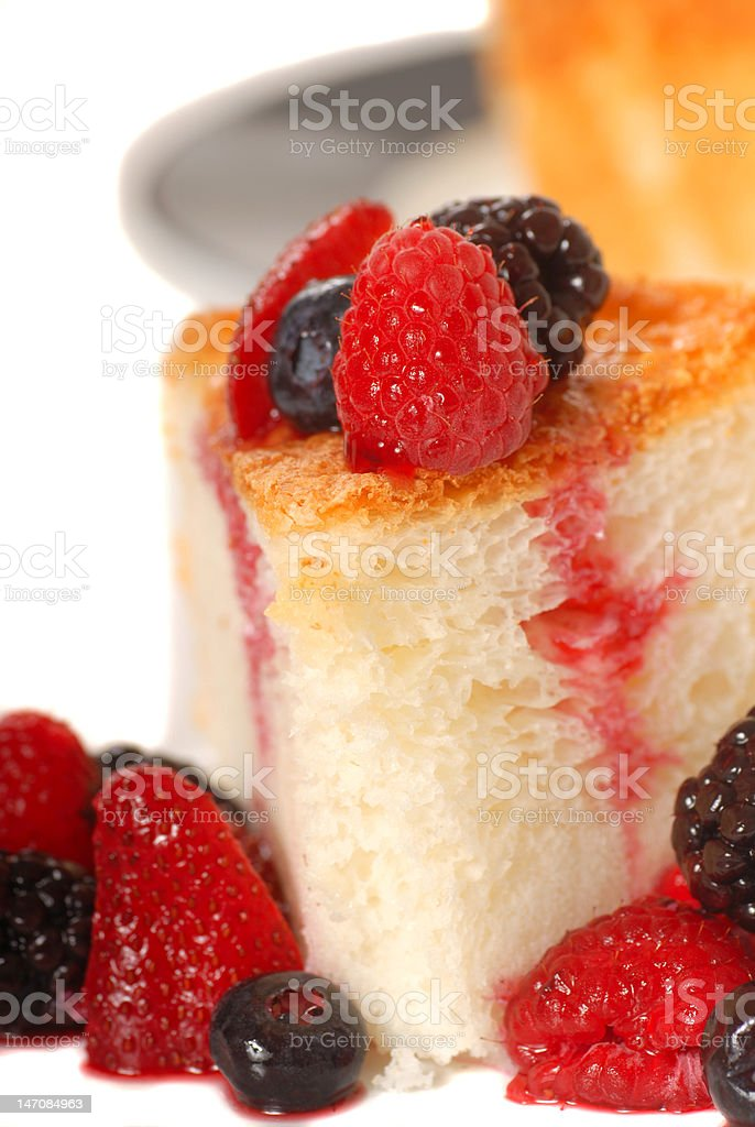 Slice of Angel Food Cake with fresh fruit royalty-free stock photo