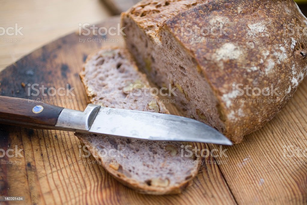 Slice of artisan bread cut from a loaf stock photo
