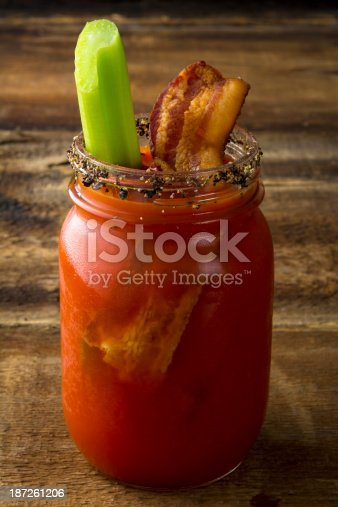 istock A slice of bacon dipped in Bloody Mary in a mason jar  187261206