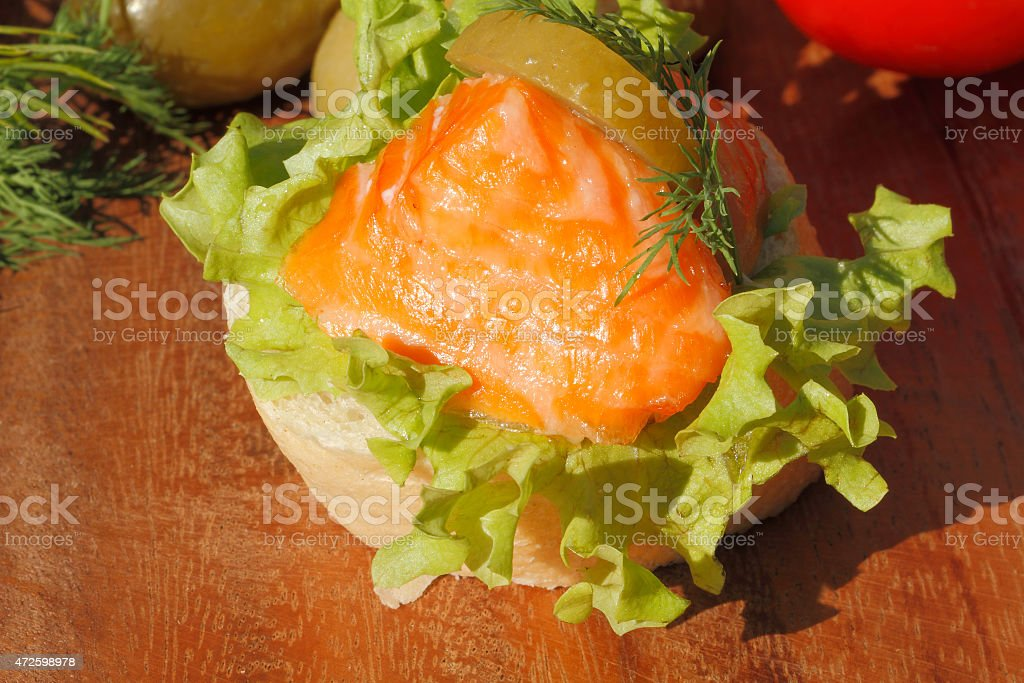 Slice of baguette with smoked salmon filet stock photo