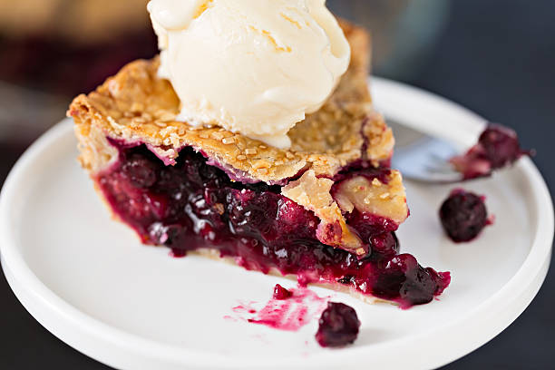 slice of berry pie and ice cream - blueberry pie stock pictures, royalty-free photos & images