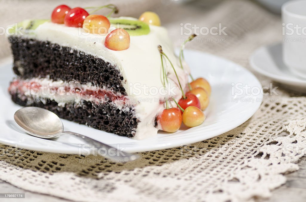 Slice of bird-cherry flour cake with cherries, strawberries and kiwi royalty-free stock photo