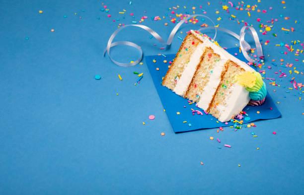 Slice of Birthday Cake on blue stock photo