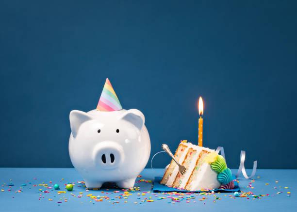 Slice of Birthday Cake with Piggy Bank stock photo
