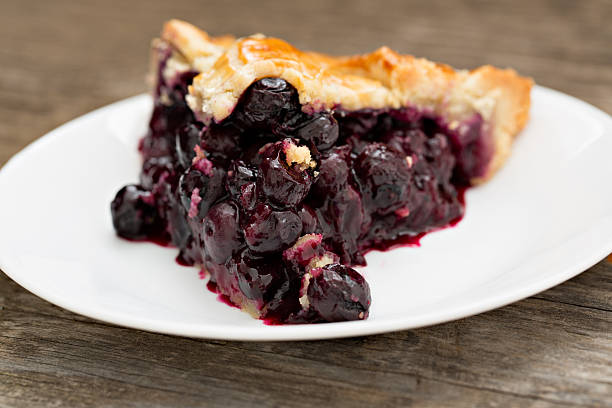 slice of blueberry pie - blueberry pie stock pictures, royalty-free photos & images