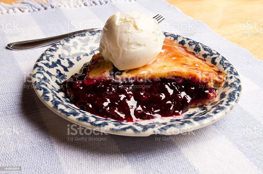 Slice of Blueberry Pie with Ice Cream stock photo