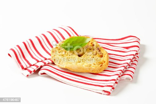 slice of white bread on striped folded placemat