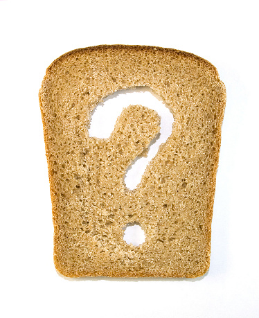 Slice Of Bread With A Question Mark Cut Out From It Stock Photo - Download Image Now