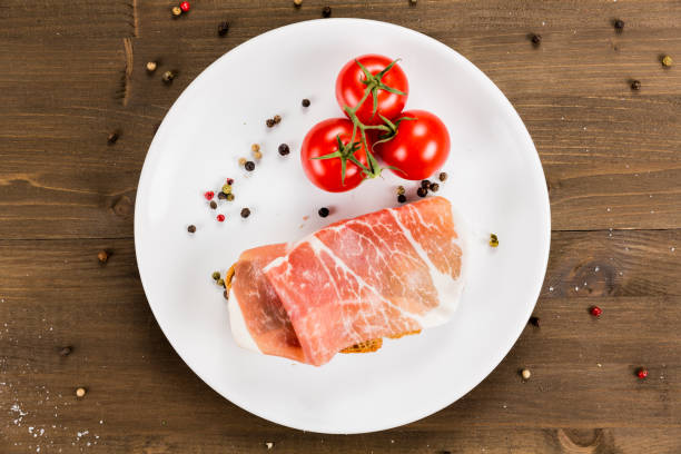 Slice of bread with preserved ham and ingredients. stock photo