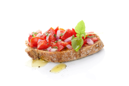 istock A slice of bruschetta with fresh tomatoes and olive oil 465786295