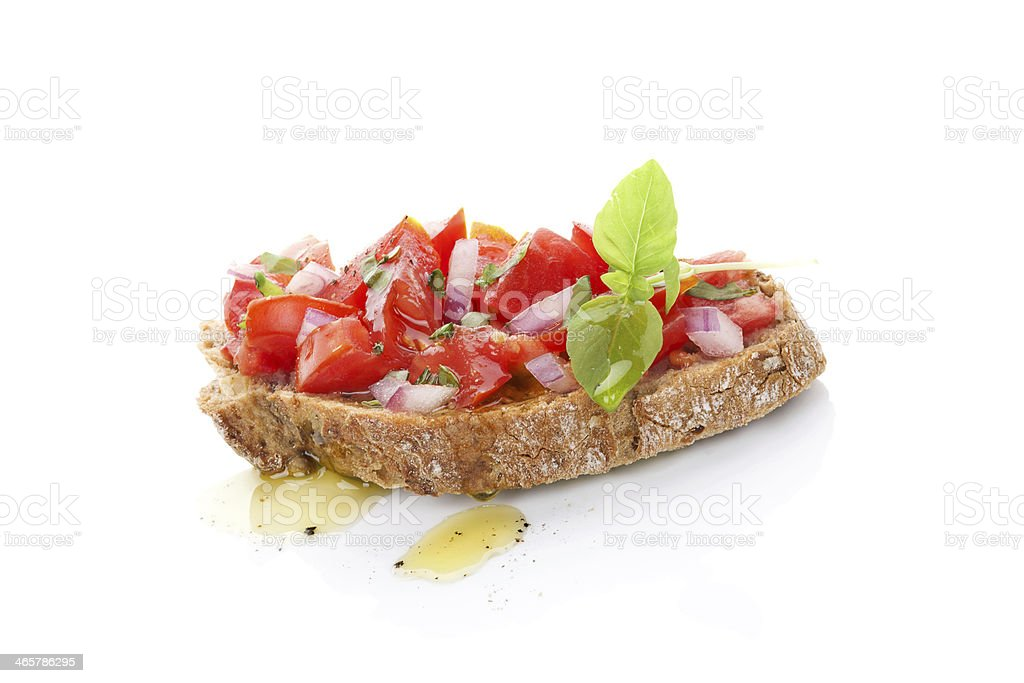 A slice of bruschetta with fresh tomatoes and olive oil stock photo