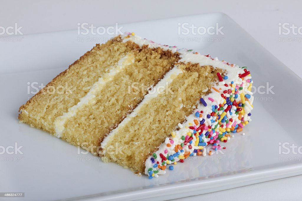 Slice of cake with sprinkles stock photo