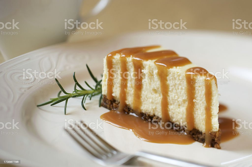 Slice of Cheesecake with Caramel Sauce stock photo