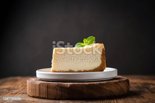 istock Slice of cheesecake with mint leaf 1097280050