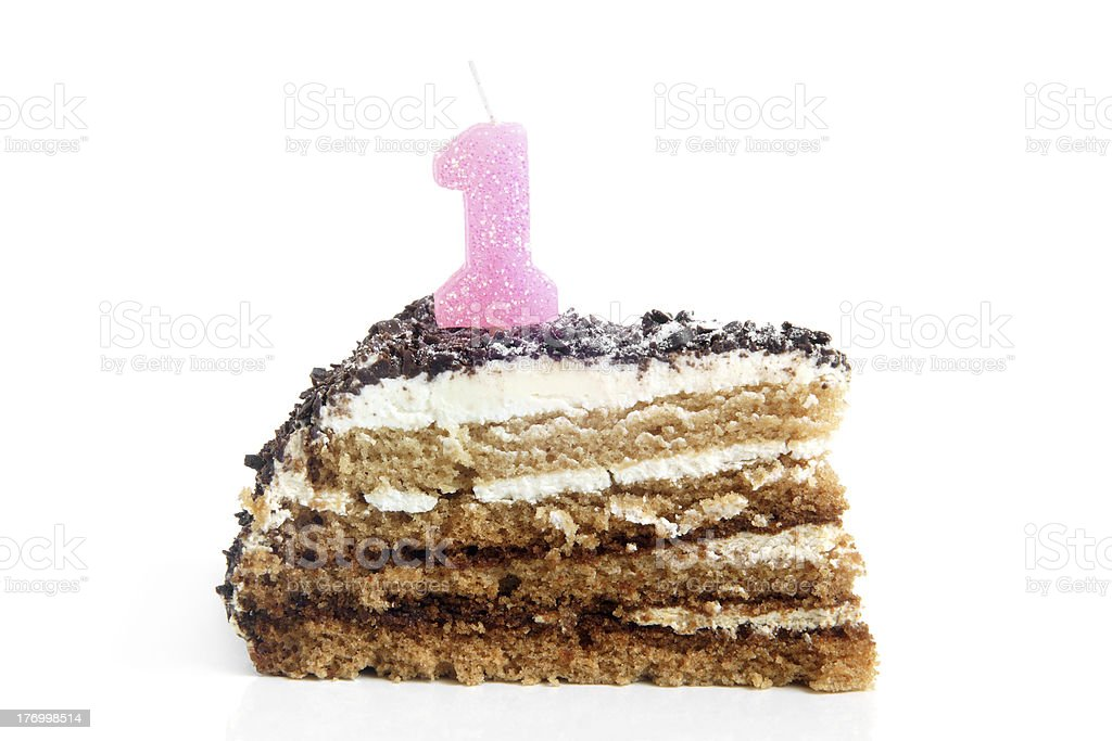 Slice of chocolate birthday cake with number one candle royalty-free stock photo