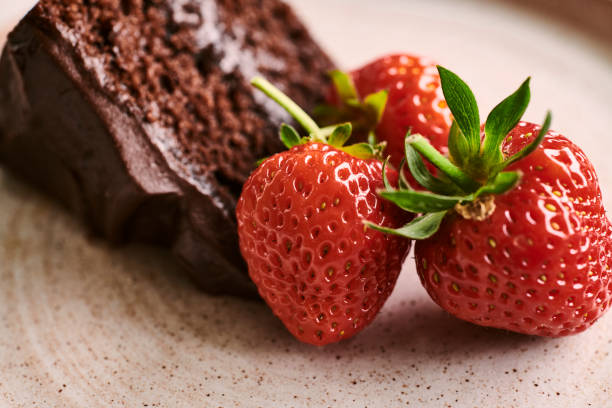 slice of chocolate cake with strawberries. - cake stock pictures, royalty-free photos & images