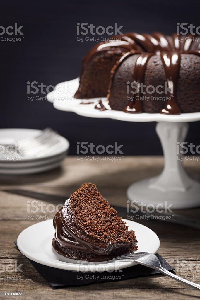 Slice of Chocolate Ganache Covered Bundt Cake stock photo