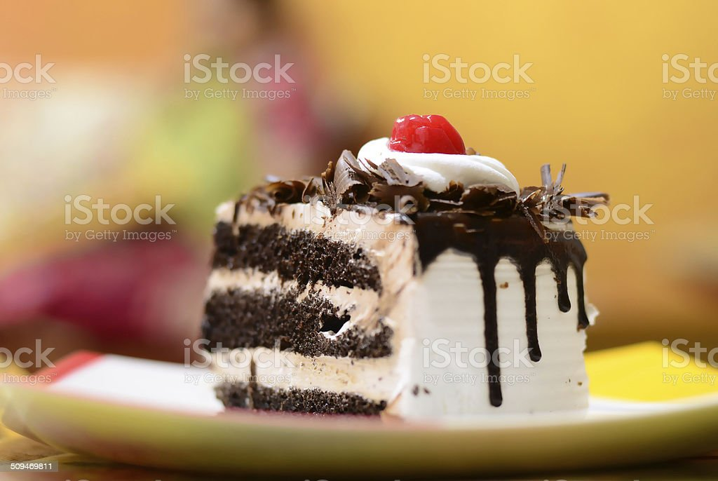 Slice of chocolate vanilla cake stock photo